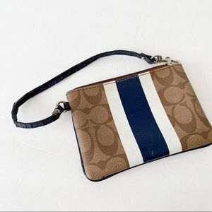 Coach tan signature print wristlet with blue
